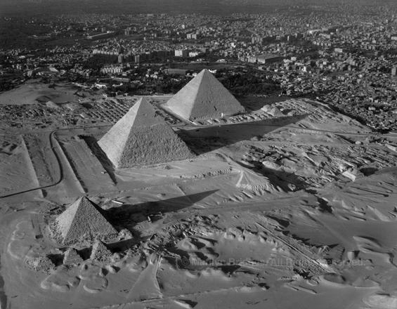 Three Pyramids of Giza with Cairo, 1993. copyright photographer Marilyn Bridges