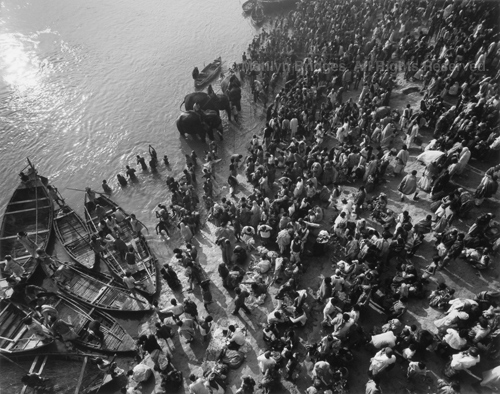 Pilgrims Praying, Elephants and Boats in Holy River, 1993. India. copyright photographer Marilyn Bridges